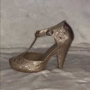 Gold glittery heels from ModCloth.